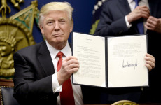 "ARLINGTON, VA - JANUARY 27: U.S. President Donald Trump signs executive orders in the Hall of Heroes at the Department of Defense on January 27, 2017 in Arlington, Virginia. Trump signed two orders calling for the ""great rebuilding"" of the nation's military and the ""extreme vetting"" of visa seekers from terror-plagued countries. (Photo by Olivier Douliery-Pool/Getty Images) Getty Images North America  695550541 632867454"